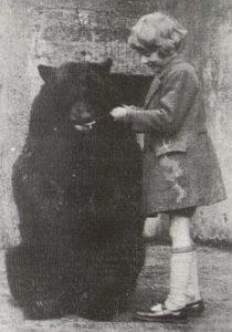 Christopher Robin Milne feeding Winnie